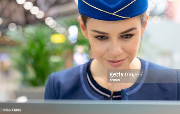 Portrait of a flight attendant working at the airport