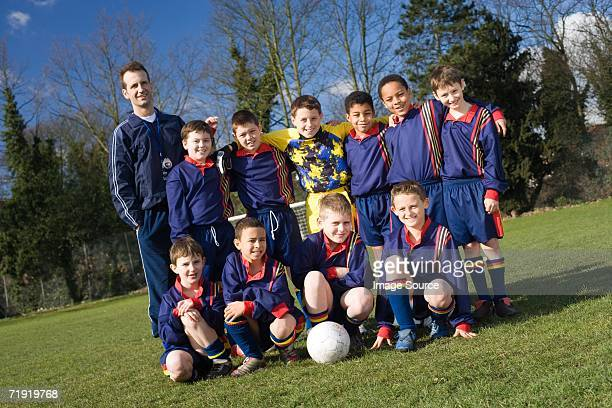 portrait of a football team - football team stock pictures, royalty-free photos & images