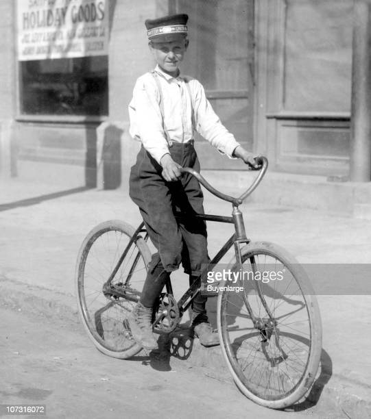 Portrait of a fourteenyearold Western Union telegraph boy as he pose on his bicycle Shreveport Louisiana 1913
