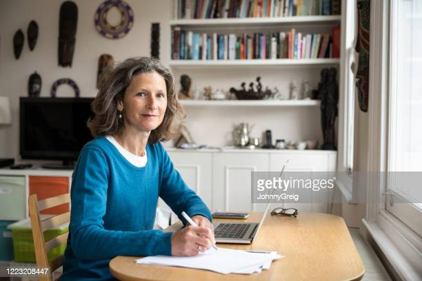 portrait of a freelance businesswoman working from home - looking at camera stock pictures, royalty-free photos & images