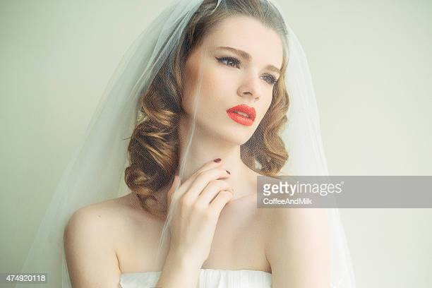 portrait of a fresh and lovely bride wearing veil - wedding veil stock photos and pictures