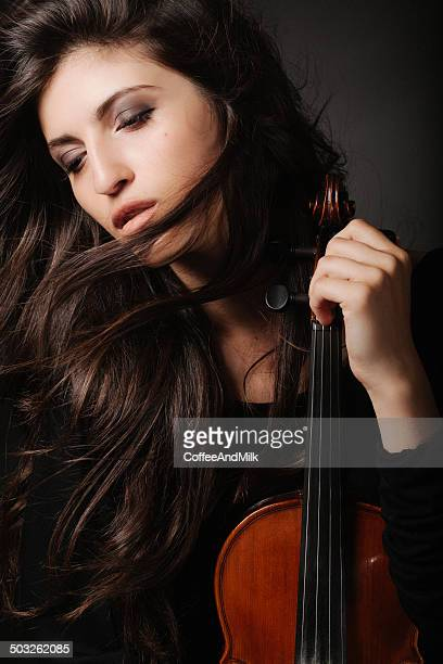 Portrait of a fresh and lovely woman holding violin