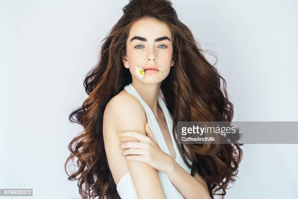 portrait of a fresh and lovely woman with flower - chamomile tea stock photos and pictures