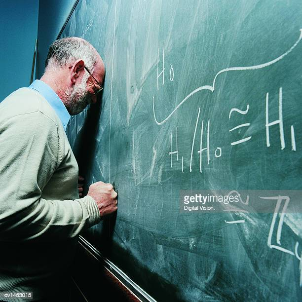 Portrait of a Frustrated Maths Lecturer Banging his Head Against a Blackboard