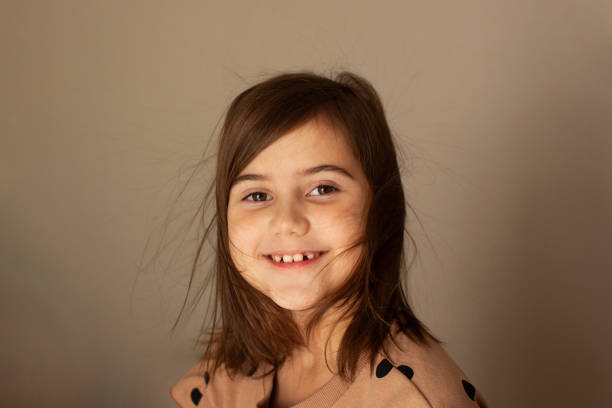 Portrait of a funny little girl.