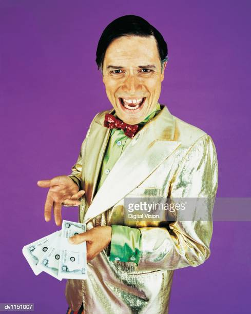 Portrait of a Game Show Host Holding Bundles of Banknotes