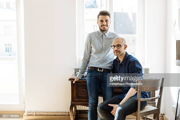 Portrait Of A Gay Couple In Their Apartment
