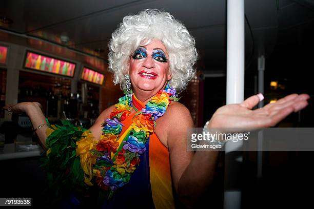 portrait of a gay man smiling - transvestite stock photos and pictures