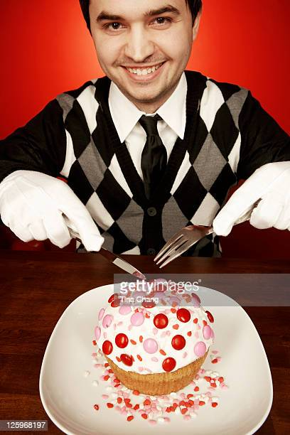 Portrait of a gentleman eating a giant cupcake