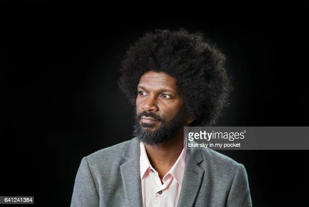 Portrait of a gentleman with Afro hair on a black background