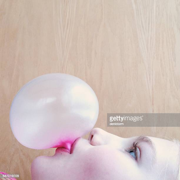 Portrait of a girl blowing a bubblegum bubble