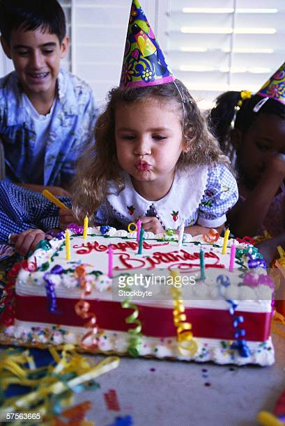 Portrait Of A Girl 6 8 Blowing Out Candles On Birthday Cake