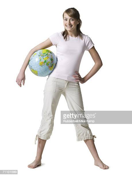 Portrait of a girl carrying a globe