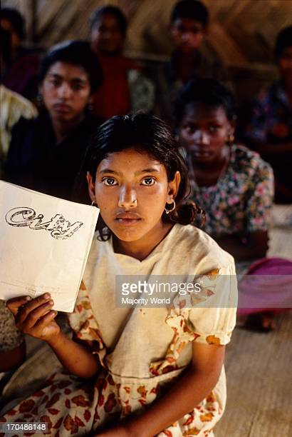 A portrait of a girl child in the classroom of a non formal school setup by CONCERN in Khaliajuri Netrokona Bangladesh Education is fundamental to...