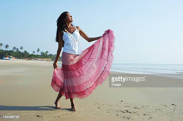 Portrait of a girl dancing on a beach