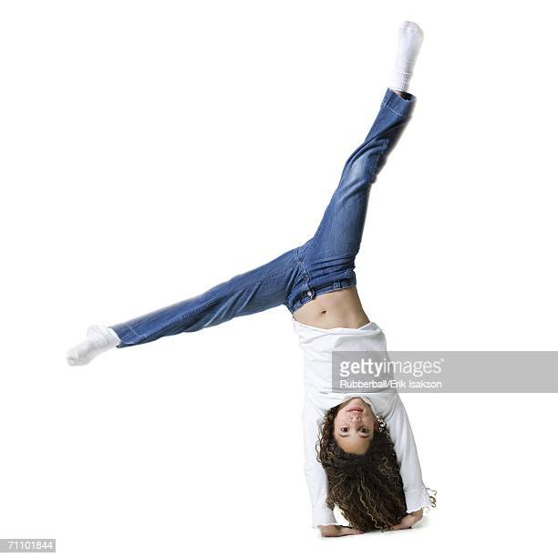 portrait of a girl doing a cartwheel - cartwheel stock pictures, royalty-free photos & images