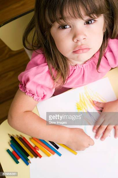 portrait of a girl drawing on a sheet of paper - colouring stock pictures, royalty-free photos & images