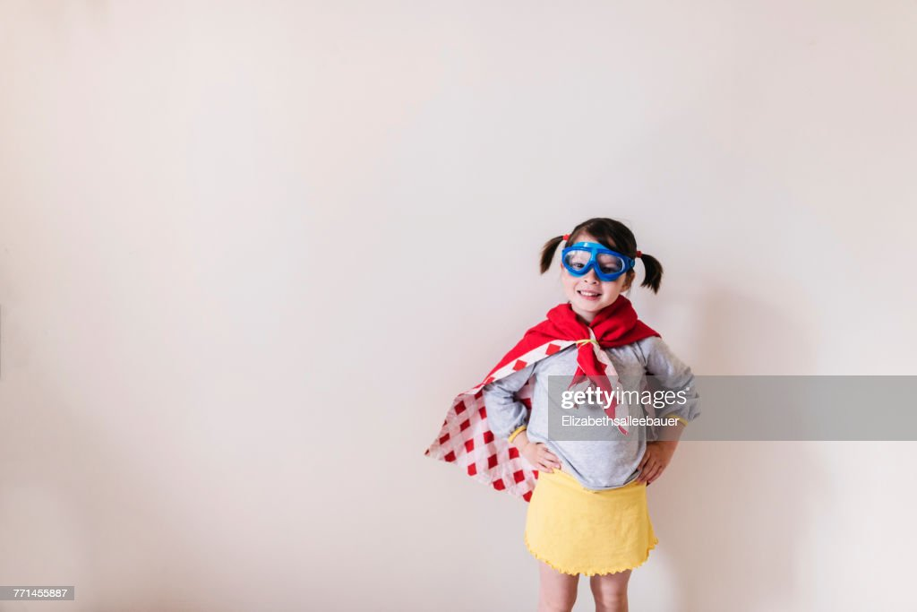 Portrait of a girl dressed as a superhero : Stock Photo