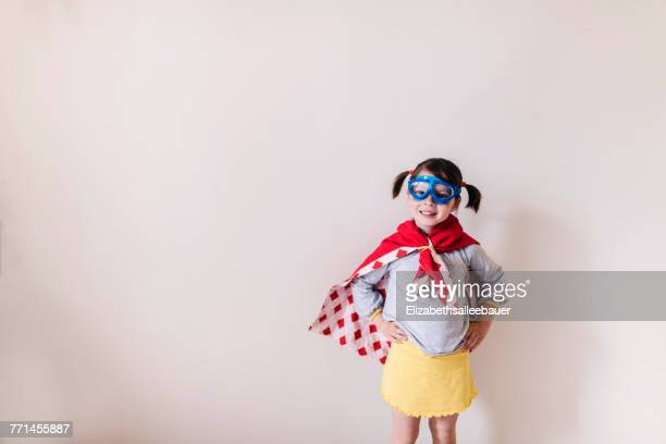 portrait of a girl dressed as a superhero - mask disguise stock pictures, royalty-free photos & images