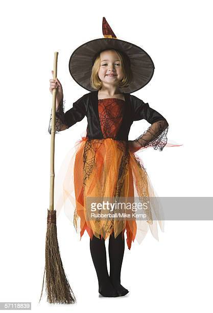 Portrait of a girl dressed as a witch and holding a broom