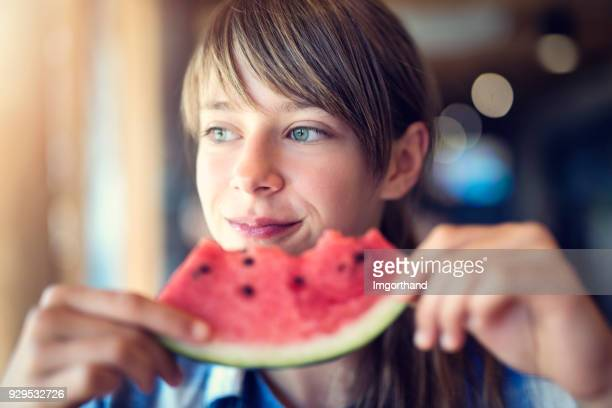 Portrait of a girl eating watermelon