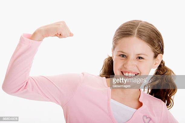 Portrait of a girl flexing her biceps