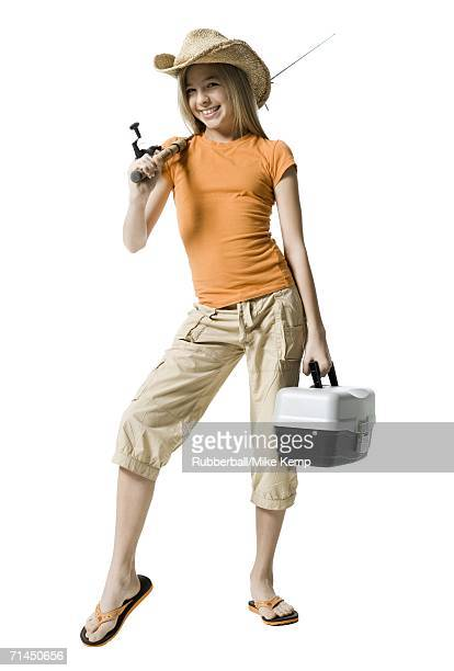 Portrait of a girl holding a fishing rod