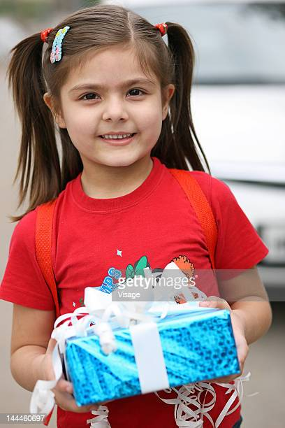 Portrait of a girl holding a gift