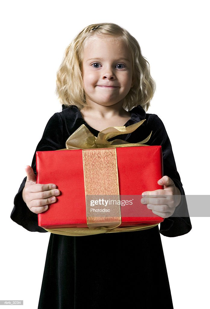 Portrait of a girl holding a gift : Foto de stock
