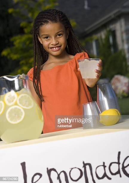 Portrait of a girl holding a glass of lemonade