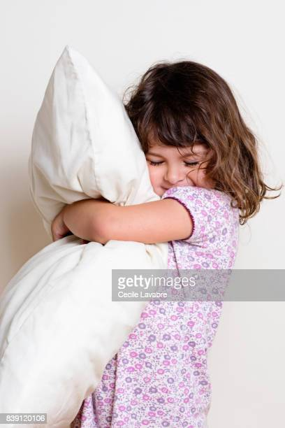 Portrait of a girl holding a pillow