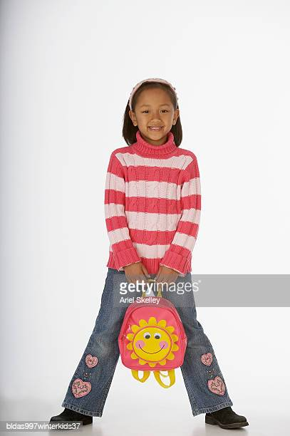 Portrait of a girl holding a schoolbag