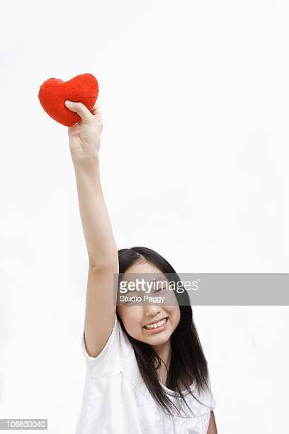 Portrait of a girl holding a valentine heart