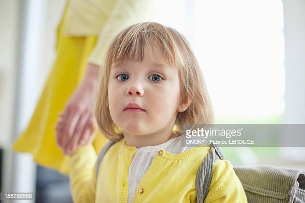 portrait of a girl holding hand of her mother - sezione centrale foto e immagini stock
