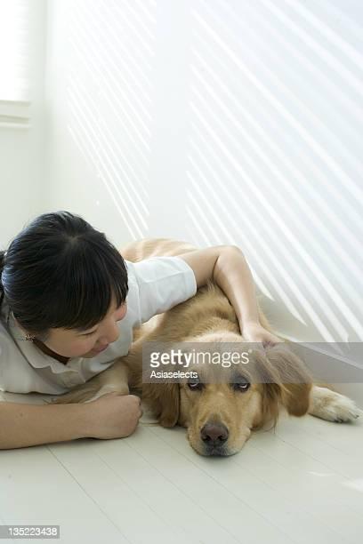 Portrait of a girl hugging her pet dog