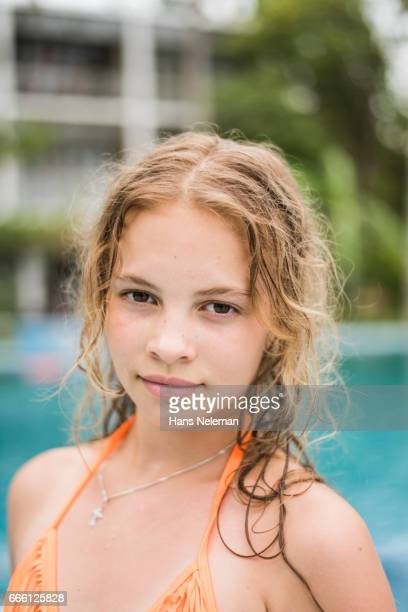 portrait of a girl in a pool - only teenage girls stock pictures, royalty-free photos & images