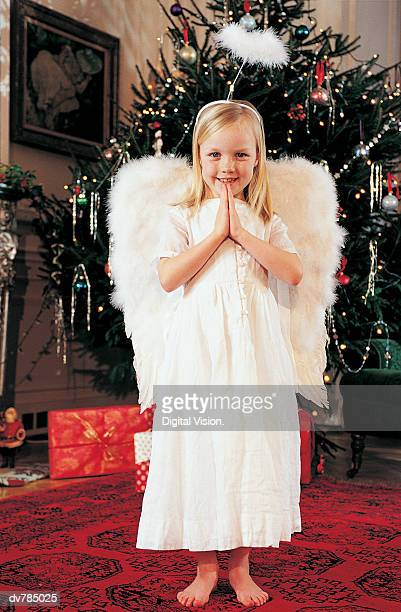 Portrait of a Girl in an Angel's Costume at Christmas