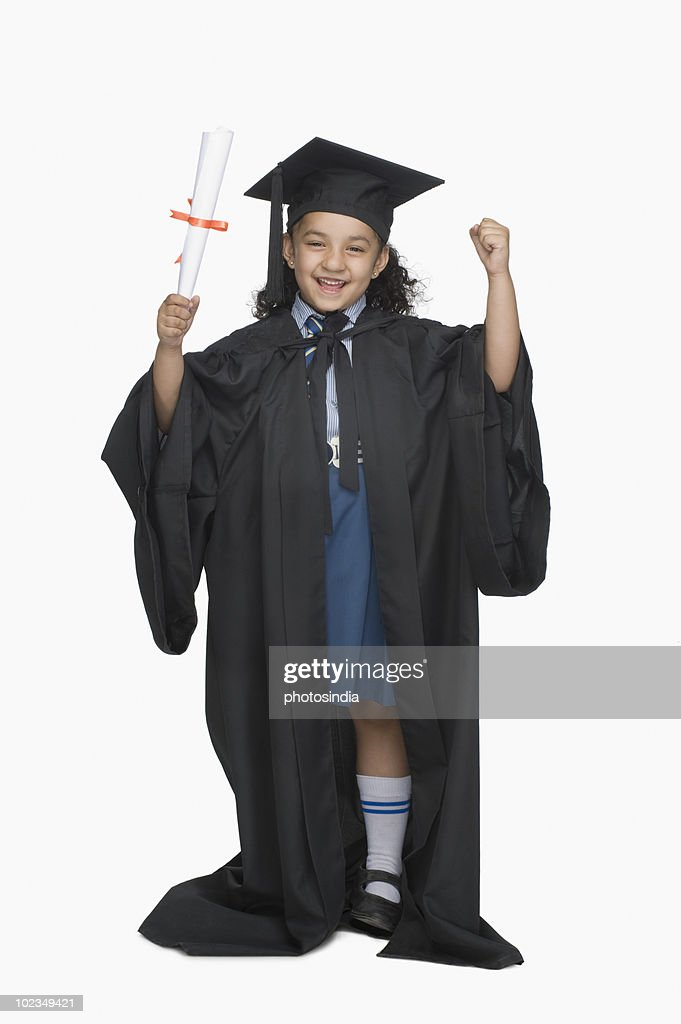 Portrait Of A Girl In Graduation Gown Holding A Diploma Stock Photo ...