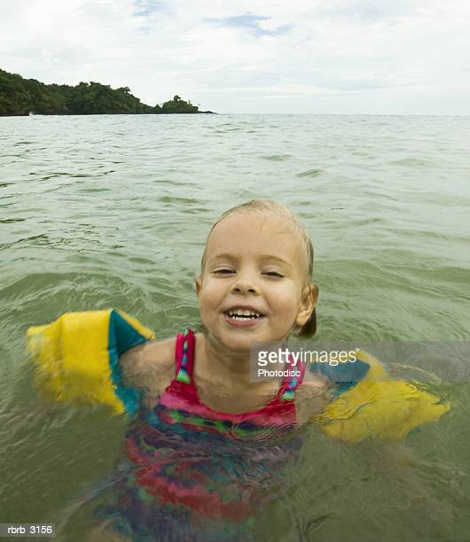 Portrait of a girl in the water at the beach