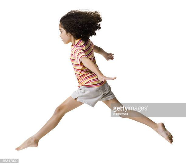 Portrait of a girl jumping with her arms outstretched