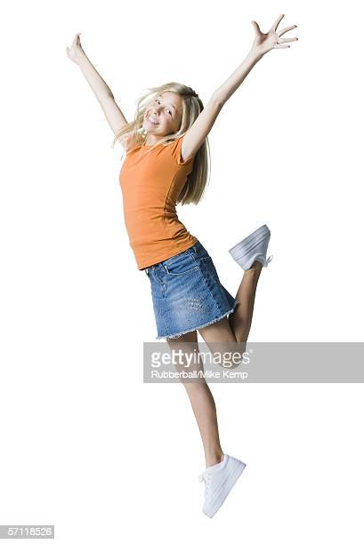 Portrait of a girl jumping with her arms raised