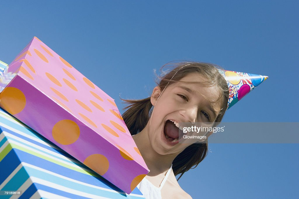 Portrait of a girl laughing with birthday presents : Foto de stock