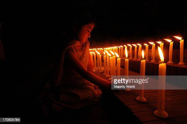 Portrait of a girl lighting candles at the Shahid minar on the eve of World Womens' Day Dhaka Bangladesh December 8 2005