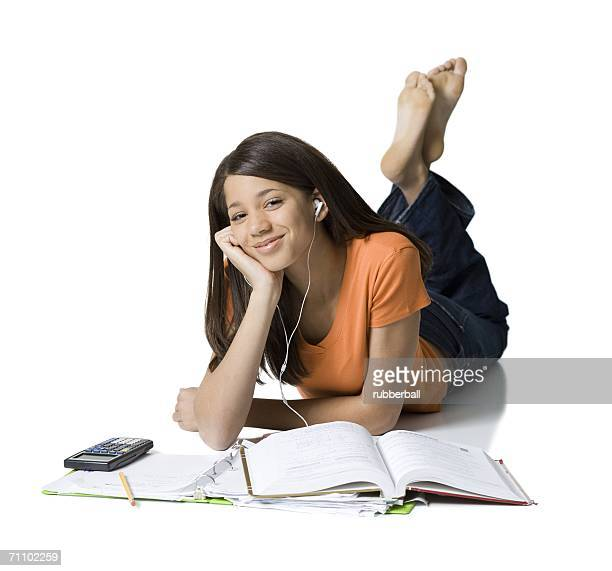 portrait of a girl listening to music and studying - soles pose stock photos and pictures
