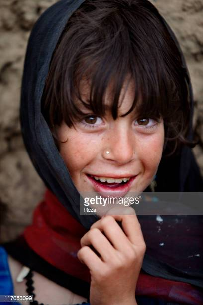 Portrait of a girl living in the camp in the North of Kabul the Charahi Qambar camp shelters refugees from Helmand province where the International...