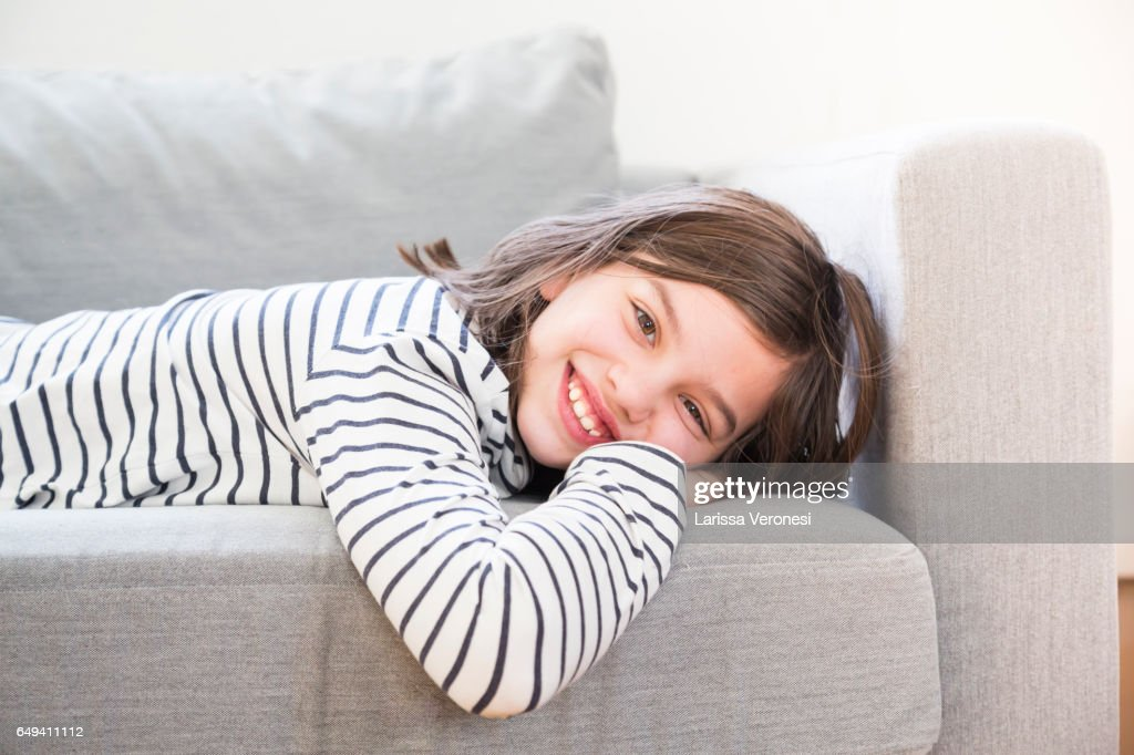 Portrait of a girl lying on sofa : Stock-Foto