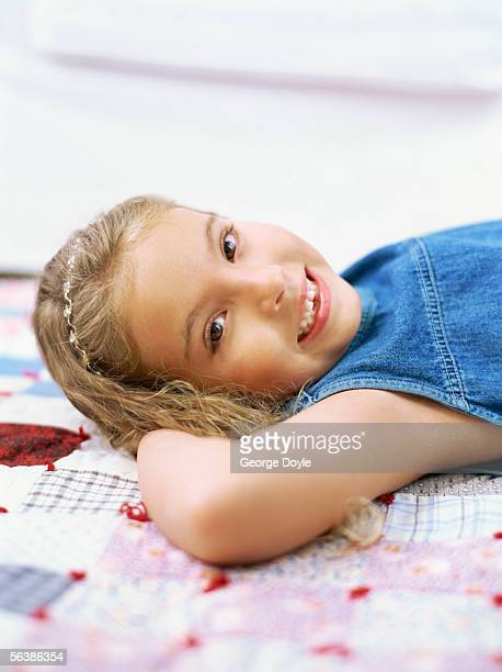 portrait of a girl lying on the bed - little girls bare bum stock pictures, royalty-free photos & images