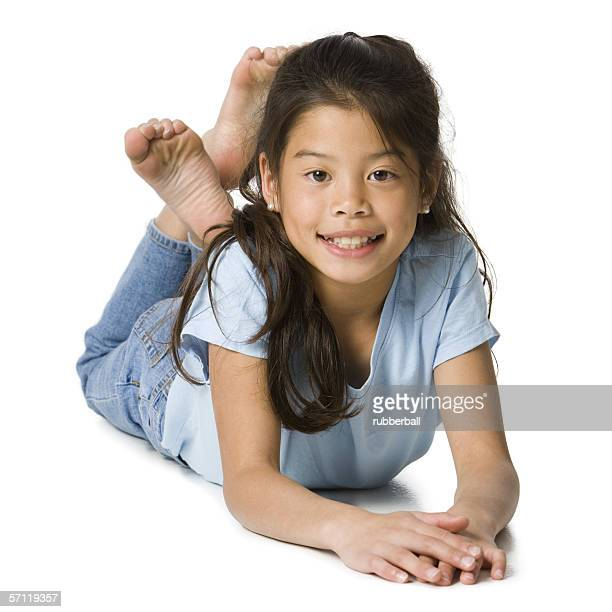 Portrait of a girl lying on the floor and smiling