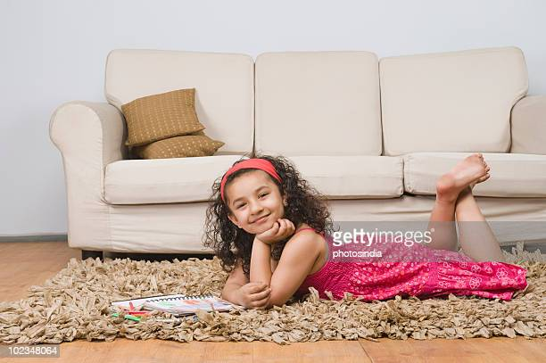 portrait of a girl lying with a notebook and colored pencils - barefoot feet up lying down girl stock photos and pictures