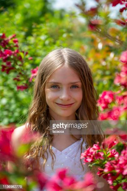 Portrait of a girl on a blossoming bush